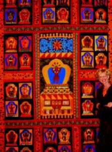 Photo of Beth Mount in front of graphic quilt